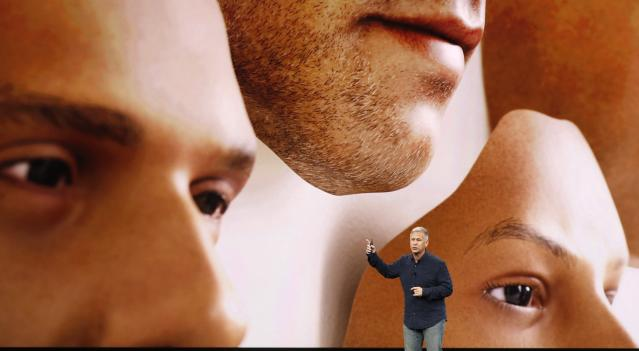 <p>Apple knows there are some concerns with face scan security, so they worked with mask makers to make sure that a photo nor a hyper-realistic mask would crack the security (but still beware of evil twins). REUTERS/Stephen Lam </p>