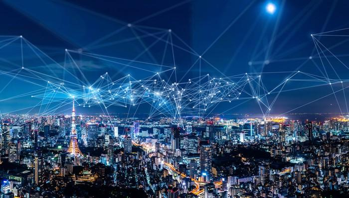 A network of connected lines over a city at night.