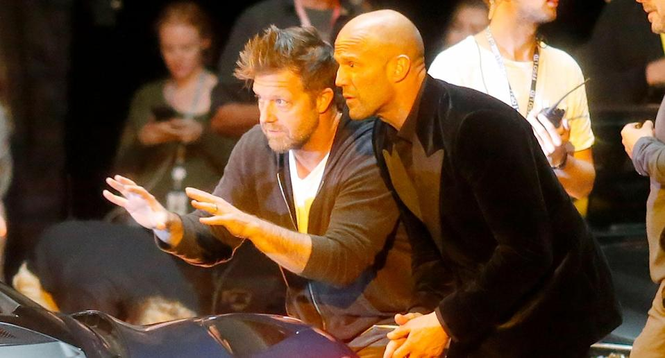 <i>Atomic Blonde</i> director David Leitch gives instructions to Jason Statham during the <i>Hobbs & Shaw</i> night shoot. (Headlinephoto/SplashNews.com)