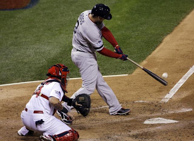 Boston Red Sox's David Ross hits an RBI double during the seventh inning of Game 5 of baseball's World Series against the St. Louis Cardinals Monday, Oct. 28, 2013, in St. Louis. (AP Photo/David J. Phillip)