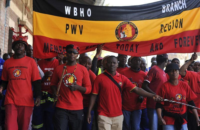 Members of the National Union of Mineworkers take part in a strike in Johannesburg