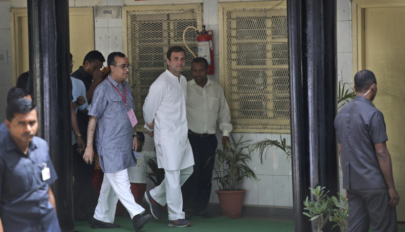 Congress party president Rahul Gandhi, center, returns after casting his vote during the sixth phase of general elections in New Delhi, India, Sunday, May 12, 2019. Indians are voting in the next-to-last round of 6-week-long national elections, marked by a highly acrimonious campaign with Prime Minister Narendra Modi flaying the opposition Congress party rival Rahul Gandhi's family for the country's ills. (AP Photo/Manish Swarup)