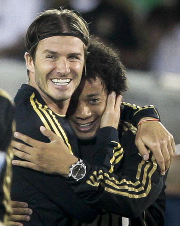 Los Angeles Galaxy's David Beckham, left, hugs Real Madrid's Marcelo after an exhibition soccer match, Saturday, July 16, 2011, at Memorial Coliseum in Los Angeles. Real Madrid won 4-1. (AP Photo/Bret Hartman)