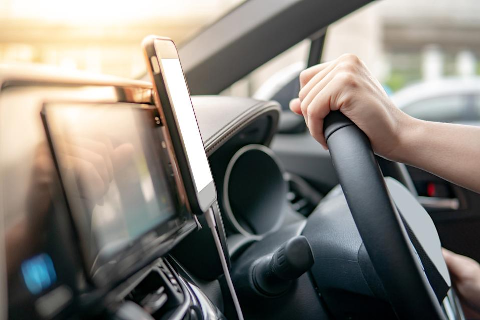 """MPs have warned that a ban on driving with hands-free phones """"should be considered"""" (Picture: Getty)"""