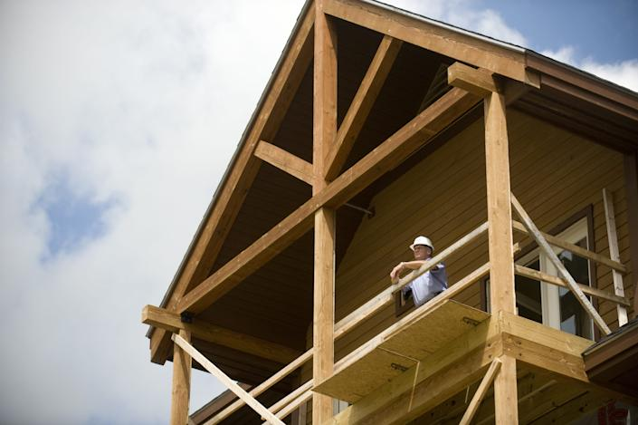 Jay Peak Resort President Bill Stenger checks the view from one of the hotel suites under construction Aug. 5, 2009.