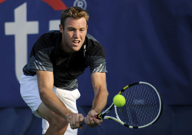 Jack Sock lunges for the ball against Michael Berrer, of Germany, during a match at the Citi Open tennis tournament, Tuesday, July 29, 2014, in Washington. (AP Photo/Nick Wass)