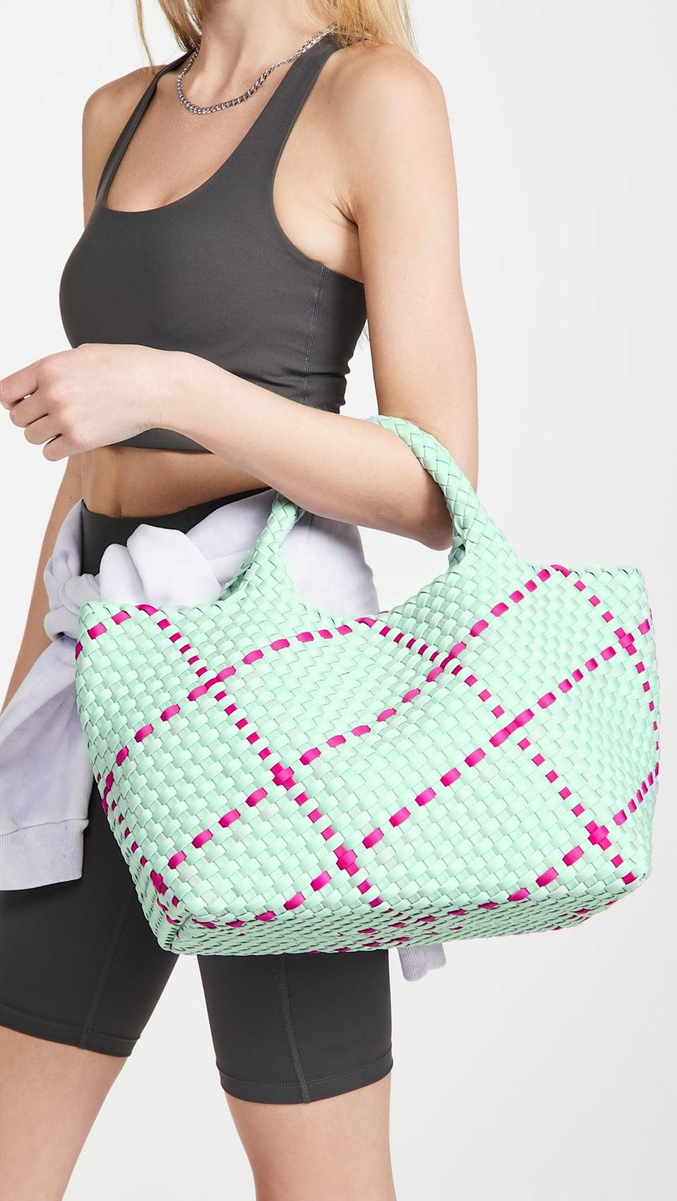 <p>Go for something colorful and different, and get the <span>Naghedi St Barths Medium Tote</span> ($240).</p>