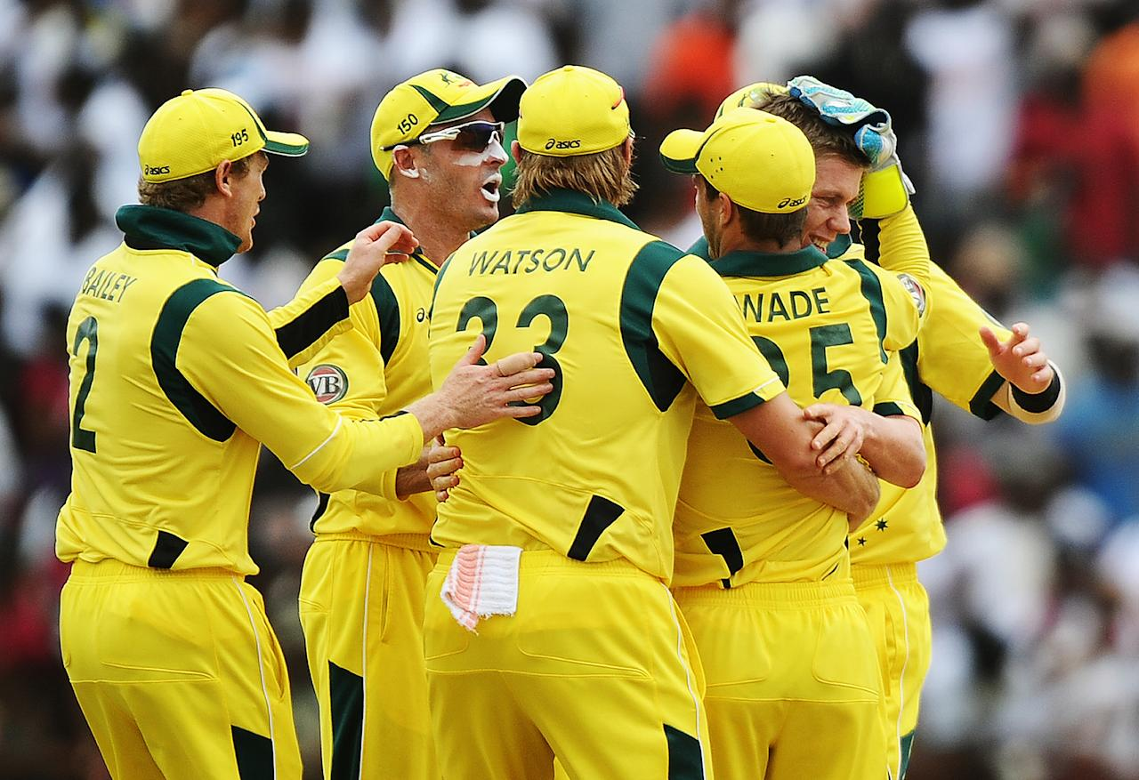 Australian cricketer Xavier Doherty (R) celebrates with teammates after dismissing West Indies batsman Kieran Powell during the third-of-five One Day International (ODI) matches between West Indies and Australia at the Arnos Vale Ground in Kingstown on March 20, 2012. Australia have scored 220/10 at the end of their innings.    AFP PHOTO/Jewel Samad (Photo credit should read JEWEL SAMAD/AFP/Getty Images)