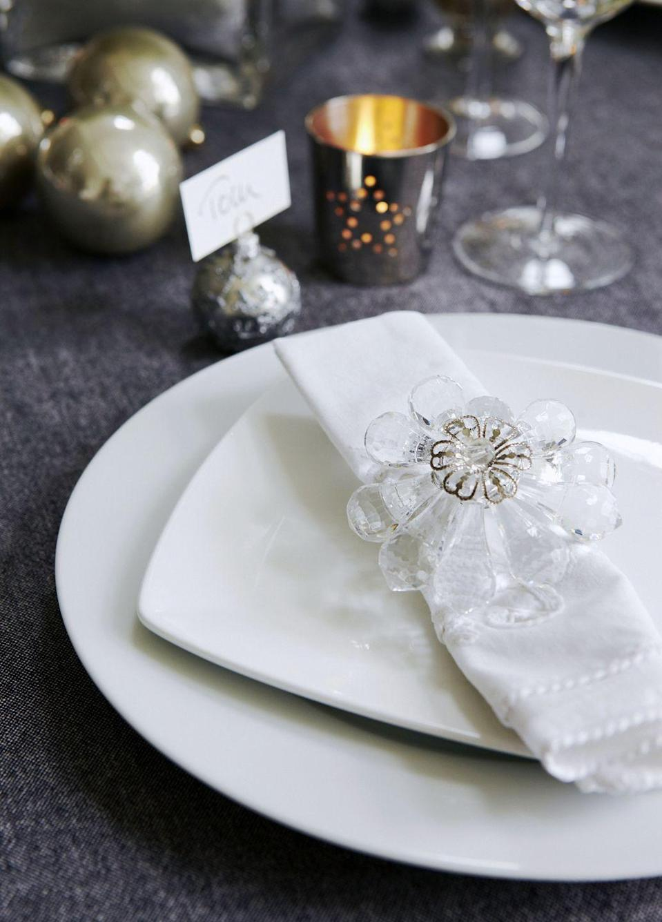 """<p>Bring a dose of nature and elegance to your table with the addition of floral napkin rings. </p><p><a class=""""link rapid-noclick-resp"""" href=""""https://go.redirectingat.com?id=74968X1596630&url=https%3A%2F%2Fwww.bedbathandbeyond.com%2Fstore%2Fproduct%2Fsaro-lifestyle-beaded-floral-bouquet-napkin-rings%2F5286721&sref=https%3A%2F%2Fwww.goodhousekeeping.com%2Fholidays%2Fchristmas-ideas%2Fhow-to%2Fg2196%2Fchristmas-table-settings%2F"""" rel=""""nofollow noopener"""" target=""""_blank"""" data-ylk=""""slk:SHOP FLORAL NAPKIN RINGS"""">SHOP FLORAL NAPKIN RINGS</a></p>"""