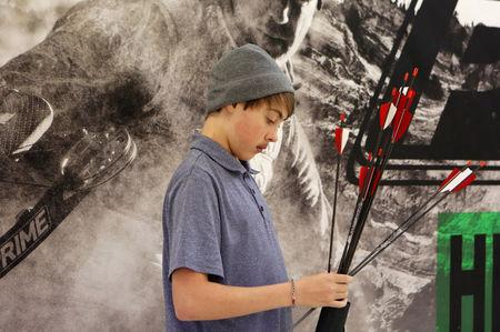 FILE PHOTO: Joshua Lemacks, 14, who has a congenital heart defect, practices archery in Richmond, Virginia, U.S. November 18, 2017.  REUTERS/Julia Rendleman/File Photo