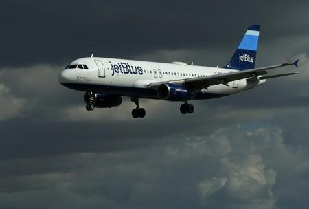 FILE PHOTO: A JetBlue aircraft comes in to land at Long Beach Airport in Long Beach