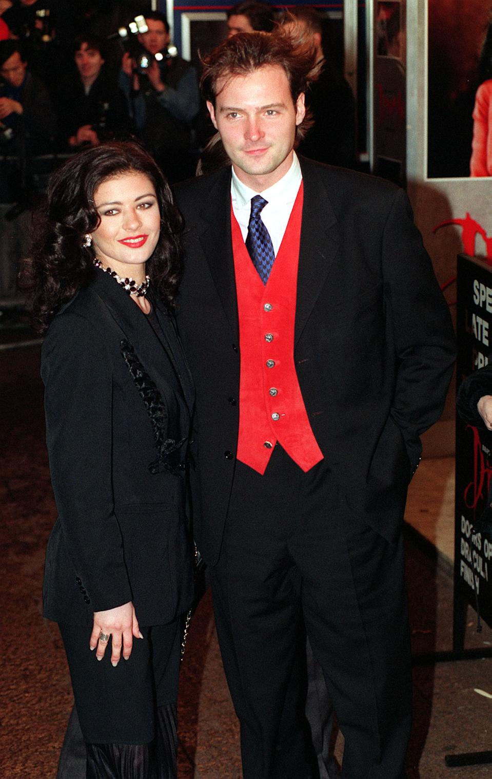 Actress Catherine Zeta Jone arrives with BBC's Blue Peter presenter John Leslie for the celebrity premiere of Bram Stoker's Dracula, directed by Francis Ford Coppola, at the Odeon Leicester Square cinema in London. (Photo by Fiona Hanson - PA Images/PA Images via Getty Images)