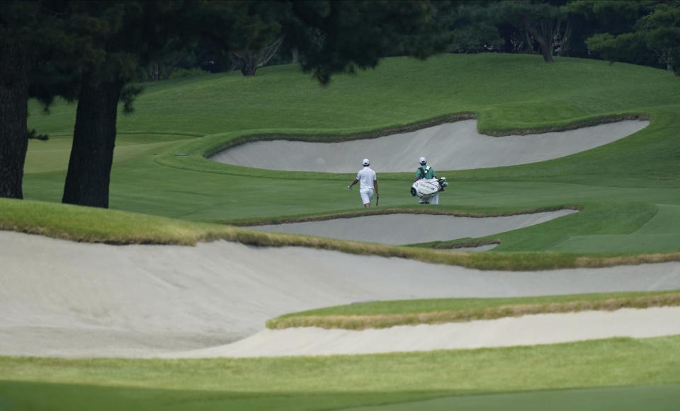 South Africa's Christiaan Bezuidenhout, left, walks on the 14th fairway during a practice round of the men's golf event at the 2020 Summer Olympics, Tuesday, July 27, 2021, at the Kasumigaseki Country Club in Kawagoe, Japan, (AP Photo/Matt York)