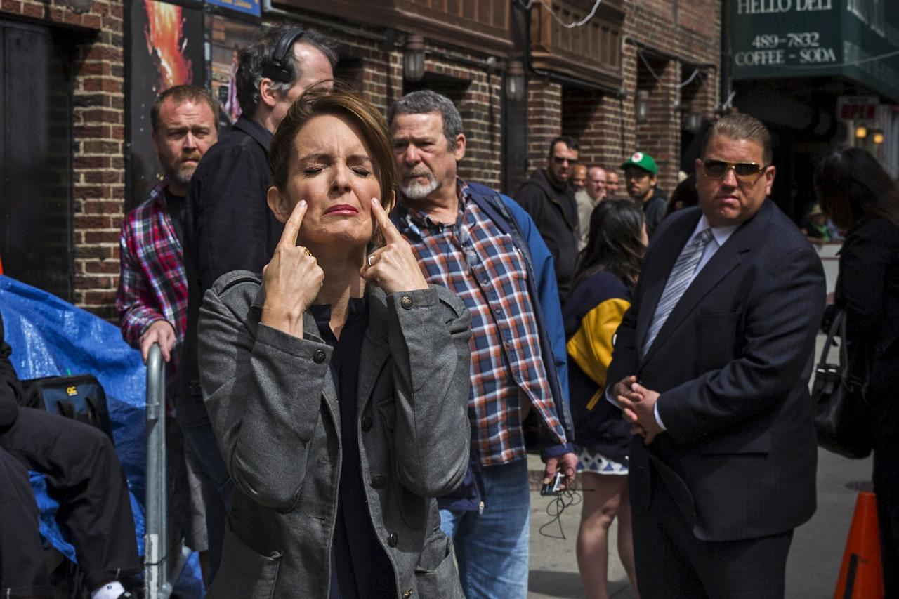 "Comedian Tina Fey pretends to cry as she arrives at Ed Sullivan Theater in Manhattan as David Letterman prepares for the taping of tonight's final edition of ""The Late Show"" in New York May 20, 2015.  REUTERS/Lucas Jackson"