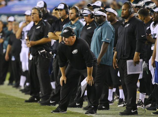 PHILADELPHIA, PA - AUGUST 21: Head coach Chip Kelly of the Philadelphia Eagles and his staff watch the game against the Pittsburgh Steelers from the sideline on August 21, 2014 at Lincoln Financial Field in Philadelphia, Pennsylvania. (Photo by Al Bello/Getty Images)