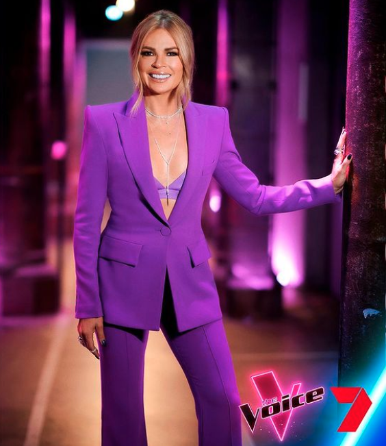 Sonia Kruger in a purple suit on The Voice