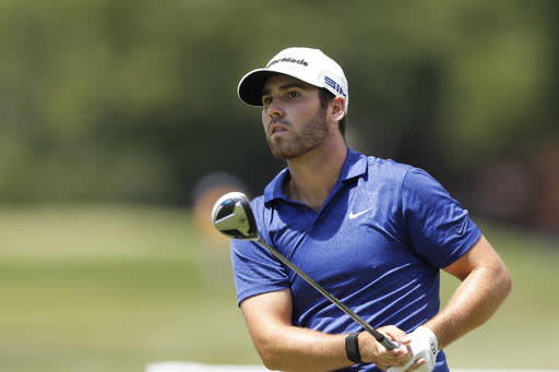 Matthew Wolff watches his drives on the second tee during the third round of the Rocket Mortgage Classic golf tournament, Saturday, July 4, 2020, at the Detroit Golf Club in Detroit. (AP Photo/Carlos Osorio)