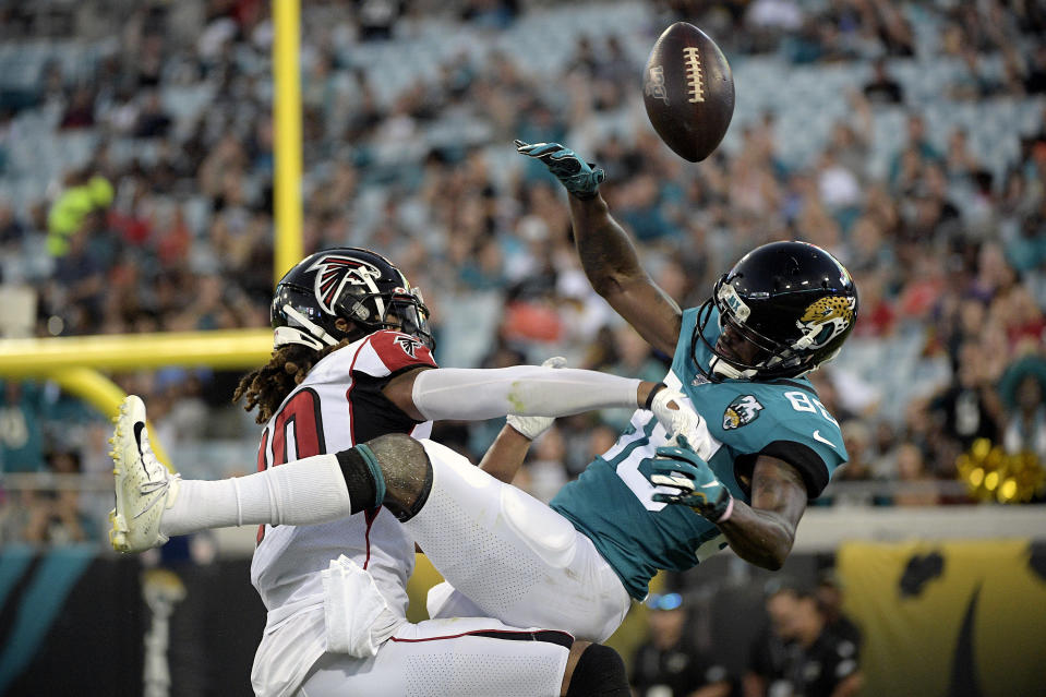 Atlanta Falcons defensive back Ryan Neal, left, breaks up a pass intended for Jacksonville Jaguars wide receiver Tre McBride, right, during the first half of an NFL preseason football game Thursday, Aug. 29, 2019, in Jacksonville, Fla. (AP Photo/Phelan M. Ebenhack)