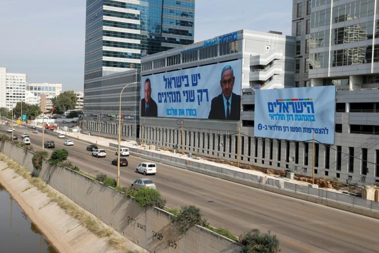 Netanyahu, appearing in an election banner with Tel Aviv Mayor Ron Huldai, is gearing up for his fourth re-election battle in two years ahead of March polls
