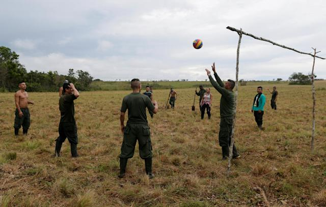 Fighters from Revolutionary Armed Forces of Colombia (FARC) play volleyball at a camp where they prepare to ratify a peace deal with the government, near El Diamante in Yari Plains, Colombia, September 19, 2016. REUTERS/John Vizcaino