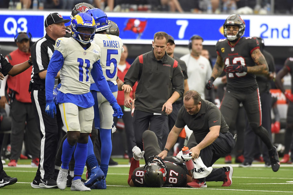 Tampa Bay Buccaneers tight end Rob Gronkowski (87) is attended after being hit by Los Angeles Rams linebacker Terrell Lewis during the second half of an NFL football game Sunday, Sept. 26, 2021, in Inglewood, Calif. (AP Photo/Kevork Djansezian)