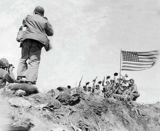 PHOTO: Marine Corps Sgt. Bill Genaust, left, and Joe Rosenthal photograph U.S. Marines at the second flag-raising on Iwo Jima during World War II, Feb. 23, 1945. (Bob Campbell/U.S. Marine Corps)