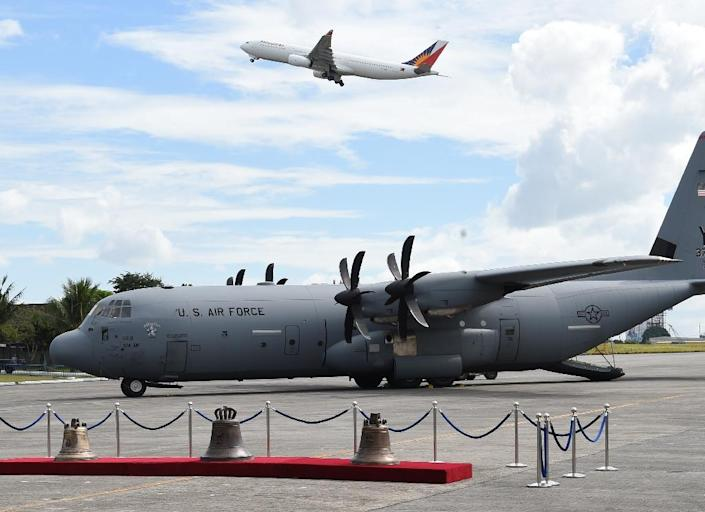 The bells were flown to a Manila Tuesday aboard an American military cargo plane (AFP Photo/TED ALJIBE)