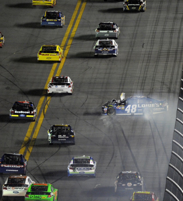 Drivers try to avoid Jimmie Johnson (48) as he crashes during the NASCAR Daytona 500 auto race at Daytona International Speedway in Daytona Beach, Fla., Monday, Feb. 27, 2012. (AP Photo/Phelan M. Ebenhack)