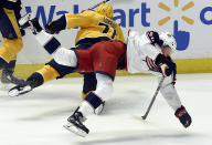 Columbus Blue Jackets left wing Eric Robinson (50) collides with Nashville Predators defenseman P.K. Subban (76) during the second period of an NHL hockey game Saturday, April 7, 2018, in Nashville, Tenn. (AP Photo/Mark Zaleski)