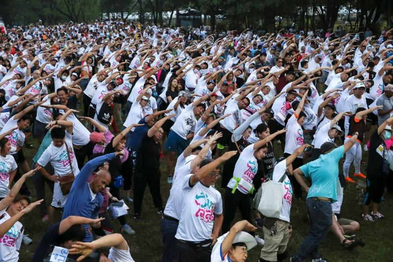 """Runners warm up as they attend the """"Run Against Dictatorship"""" event at a Public park in Bangkok"""