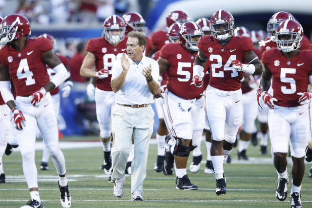 Nick Saban leads his Alabama team onto the field before a college football game. (Getty)