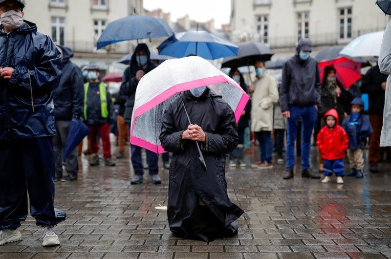 People attend an open air mass in Nantes