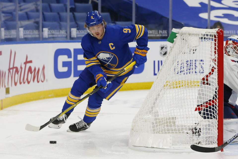 Buffalo Sabres forward Jack Eichel carries the puck during the second period of the team's NHL hockey game against the Washington Capitals, Friday, Jan. 15, 2021, in Buffalo, N.Y. (AP Photo/Jeffrey T. Barnes)