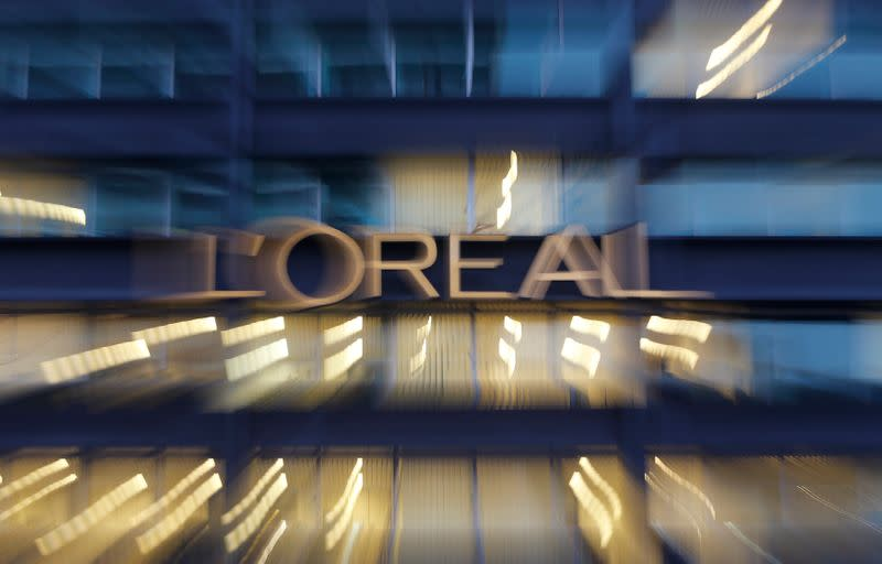 The logo of French cosmetics group L'Oreal is seen on the company's building in Clichy