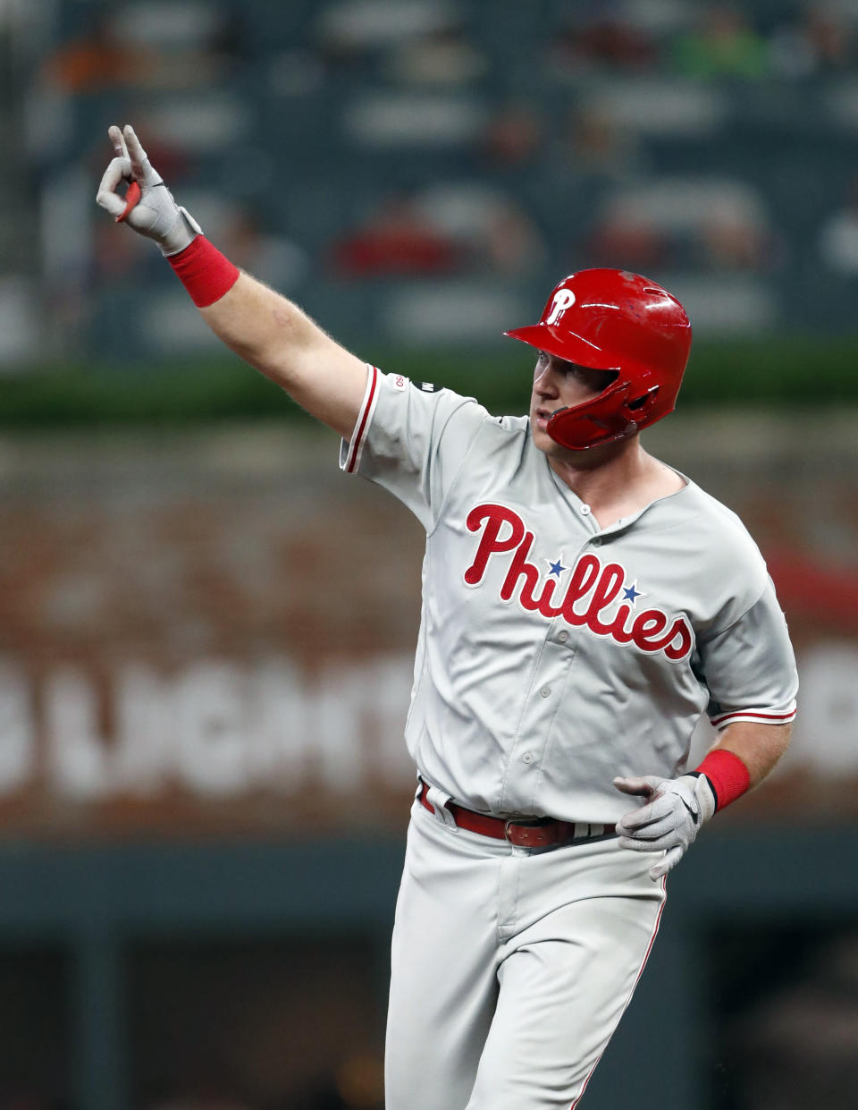 Philadelphia Phillies' Rhys Hoskins gestures as he rounds the bases after hitting a two-run home run during the seventh inning of the team's baseball game against the Atlanta Braves on Friday, June 14, 2019, in Atlanta. (AP Photo/John Bazemore)
