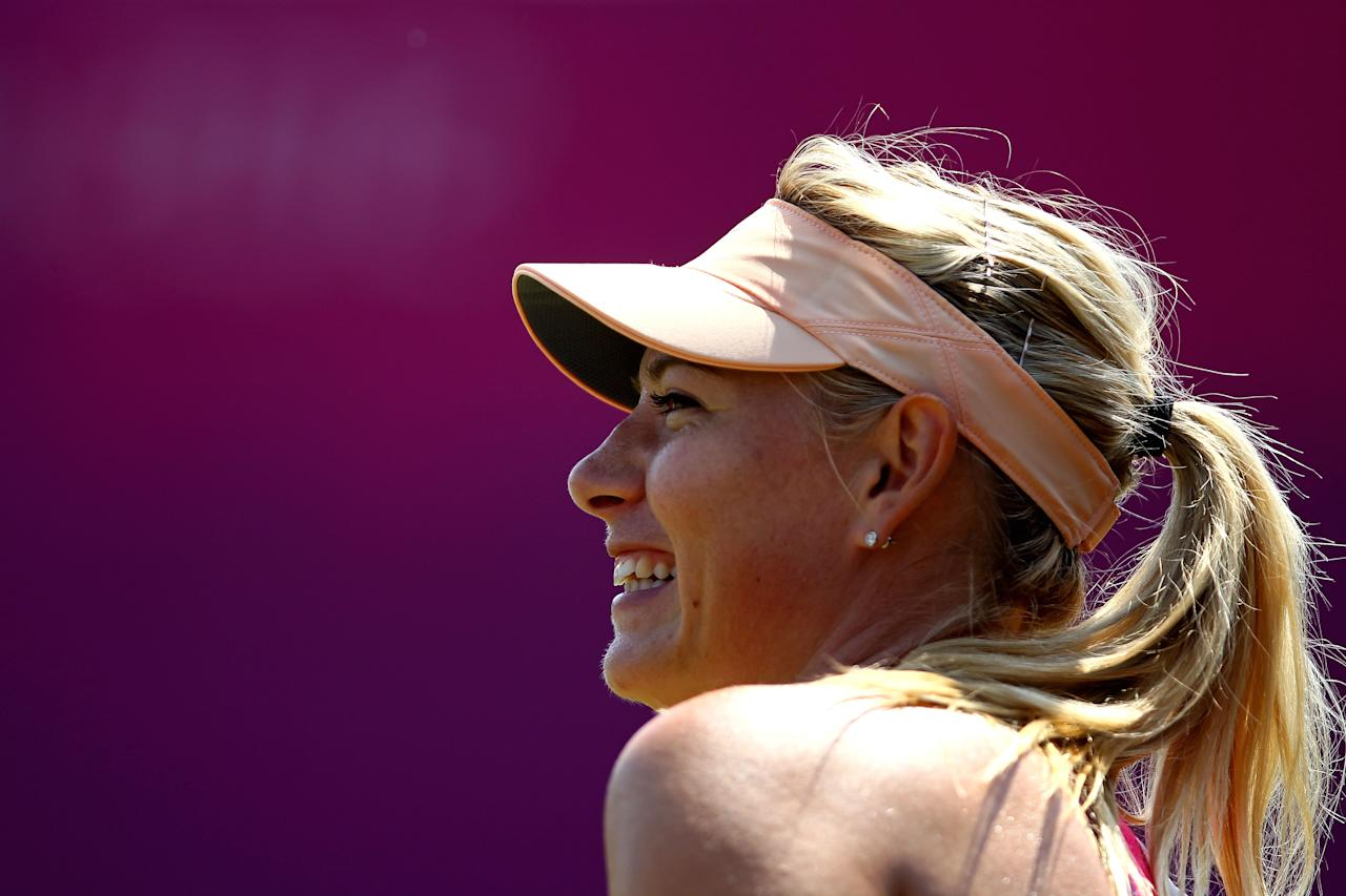 LONDON, ENGLAND - JULY 26:  Maria Sharapova of Russia smiles during the practice session ahead of the 2012 London Olympic Games at the All England Lawn Tennis and Croquet Club in Wimbledon on July 26, 2012 in London, England.  (Photo by Clive Brunskill/Getty Images)