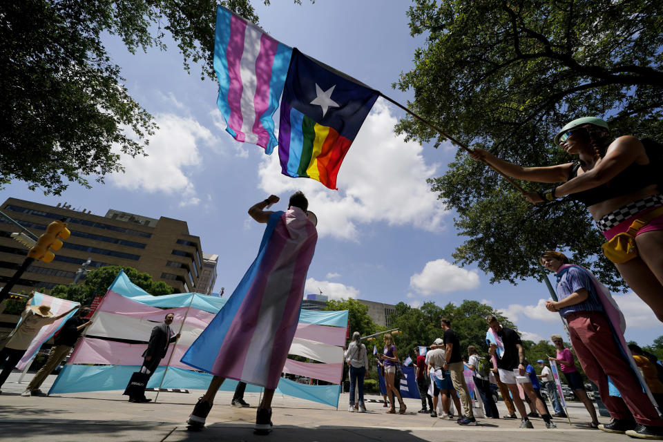 FILE - In this Thursday, May 20, 2021 file photo, demonstrators gather on the steps to the State Capitol to speak against transgender-related legislation bills being considered in the Texas Senate and Texas House in Austin, Texas. Pride Month celebrations in the U.S. are taking place under unusual circumstances in June 2021, with pandemic-related concerns disrupting many of the usual festivities and political setbacks dampening the mood of LGBTQ-rights activists. (AP Photo/Eric Gay, File)