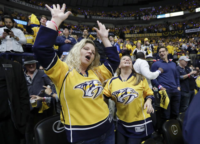 Nashville Predators fans celebrate during the third period in Game 4 of the team's first-round NHL hockey playoff series against the Chicago Blackhawks on Thursday, April 20, 2017, in Nashville, Tenn. The Predators won 4-1, sweeping the series. (AP Photo/Mark Humphrey)