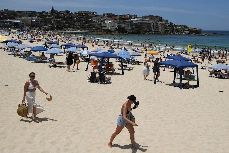 People seen on the sand during heatwave conditions at Bondi Beach in Sydney on Saturday. Source: AAP