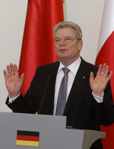 Newly elected Germany's President Joachim Gauck speaks to the media during his visit to Warsaw, Poland, Tuesday, March 27, 2012. In front a German flag symbol, behind Gauck the Polish flag. (AP Photo/Czarek Sokolowski)