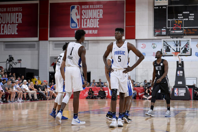 Jonathan Isaac, left, and Mo Bamba share the floor during a summer league game. (Getty)