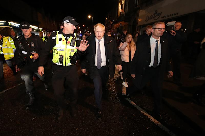 Prime Minister Boris Johnson visits Matlock, Derbyshire to view the flooding (PA)