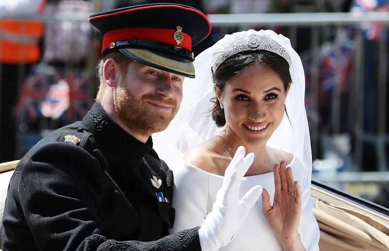 Britain's Prince Harry, Duke of Sussex and his wife Meghan, Duchess of Sussex wave from the Ascot Landau Carriage during their carriage procession on the Long Walk as they head back towards Windsor Castle in Windsor, on May 19, 2018 after their wedding ceremony. (Photo by Aaron Chown / POOL / AFP) (Photo credit should read AARON CHOWN/AFP/Getty Images)