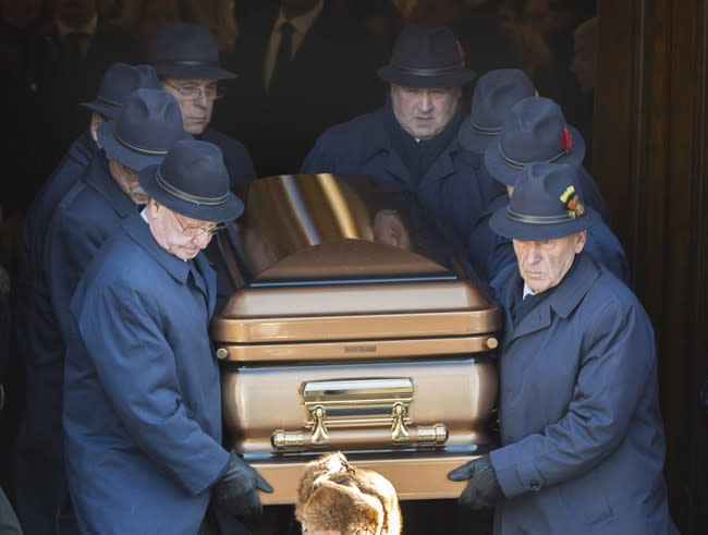 Pallbearers carry the coffin of reputed mafia boss Vito Rizzuto from a church in Montreal, Monday, Dec. 30, 2013, following his funeral. Rizzuto died last week from natural causes.THE CANADIAN PRESS/Graham Hughes