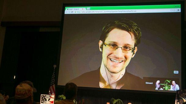 PHOTO: Edward Snowden appears on a live video feed broadcast from Moscow at an event sponsored by the ACLU Hawaii in Honolulu, Feb. 14, 2015. (Marco Garcia/AP, FILE)