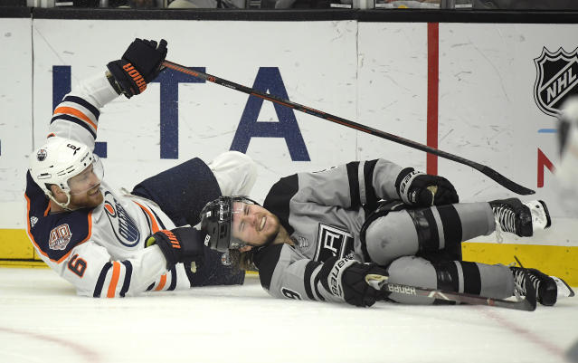 Los Angeles Kings center Adrian Kempe, right, winces after colliding with Edmonton Oilers defenseman Adam Larsson during the second period of an NHL hockey game, Saturday, Jan. 5, 2019, in Los Angeles. (AP Photo/Mark J. Terrill)