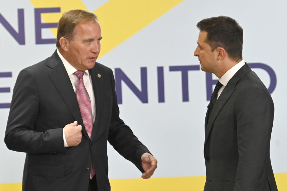 Ukrainian President Volodymyr Zelenskyy, right, and Swedish Prime Minister Stefan Lofven talk during the Crimean Platform Summit in Kyiv, Ukraine, Monday, Aug. 23, 2021. The Crimean Platform, an international summit called by Ukraine to build up pressure on Russia over the annexation that has been denounced as illegal by most of the world, opened in Kyiv on Monday. (Ukrainian Presidential Press Office via AP)