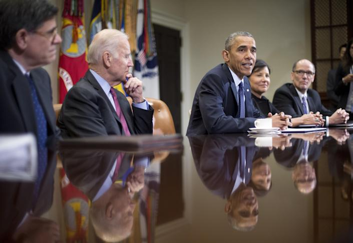 President Barack Obama, center, meets with members of his economic team in the Roosevelt Room of the White House in Washington, Friday, March 4, 2016. Obama spoke about U.S. employers adding 242,000 workers in February, driving another solid month for the resilient American job market. From left are, Treasury Secretary Jack Lew, Vice President Joe Biden, the president, Commerce Secretary Penny Pritzker, and Labor Secretary Thomas E. Perez. (AP Photo/Pablo Martinez Monsivais)
