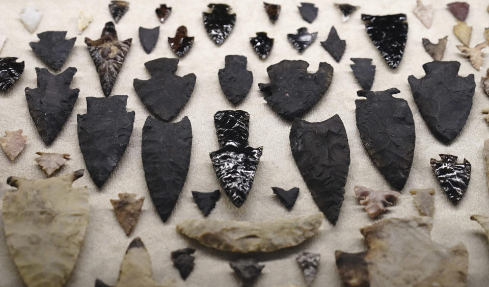 """A collection of arrowheads are shown as part of the exhibition """"The Greatness of Mexico"""" displaying for the first time in the country more than 800 pieces repatriated from abroad in the last three years and others that were in safekeeping and confiscation warehouses, at the Anthropology Museum in Mexico City, Friday, Oct. 1, 2021. (AP Photo/Marco Ugarte)"""