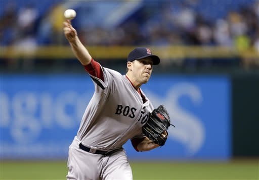 Boston Red Sox starting pitcher John Lackey delivers to Tampa Bay Rays' Desmond Jennings during the first inning a baseball game Tuesday, May 14, 2013, in St. Petersburg, Fla. (AP Photo/Chris O'Meara)